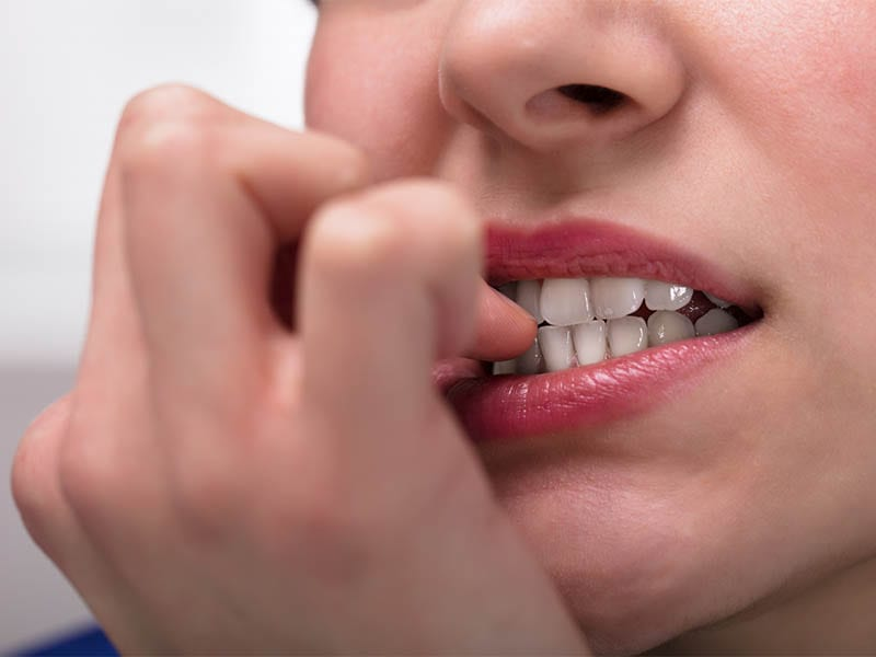 Businesswoman Biting Her Fingernail