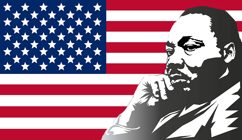 Martin Luther King in thought with American flag in the background